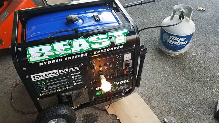 the beast portable generator next to a propane tank