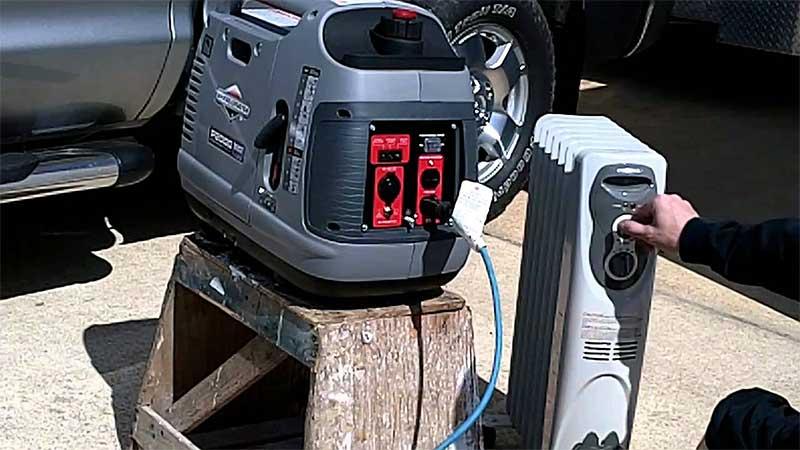 man plugging a briggs & stratton generator