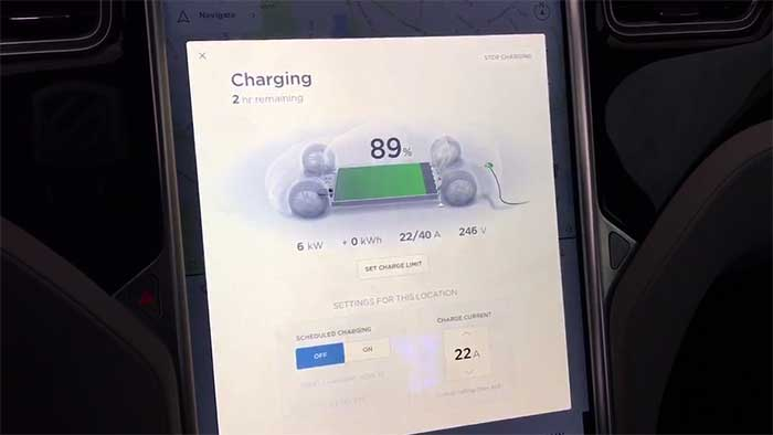 tesla monitor showing the charging screen