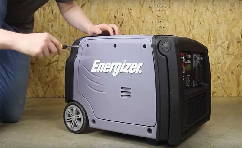 unscrewing an energizet generator's front panel
