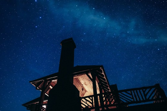 well-lighted rooftop balcony of a house