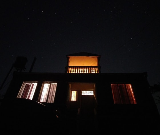night front view of well-lighted house