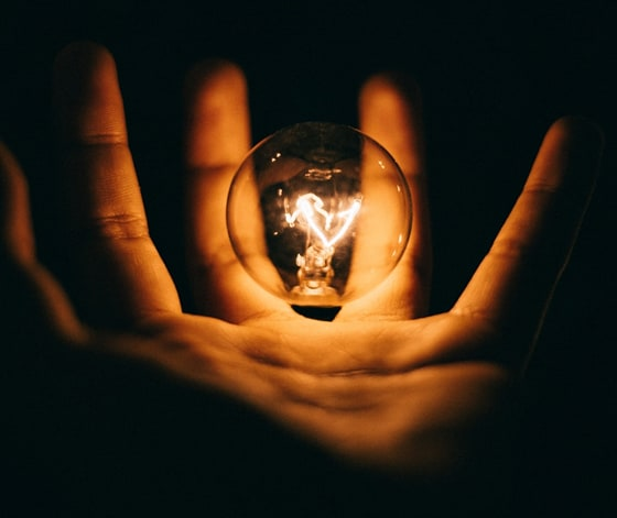a hand holding crystal ball