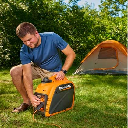Man plugging a portable generator