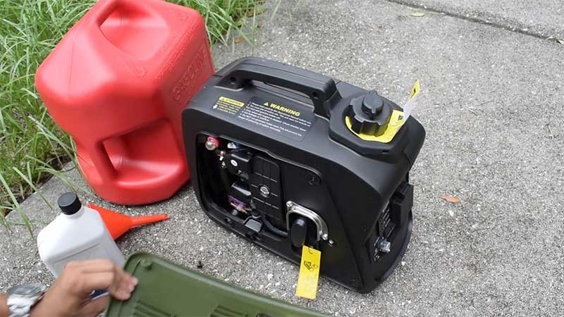 portable generator next to a gas tank