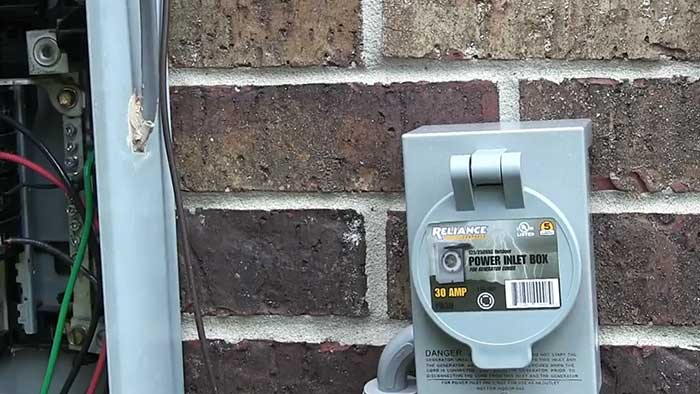 power inlet box on a brick wall