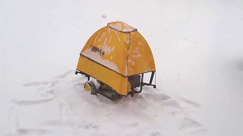 Gentent generator cover in the snow