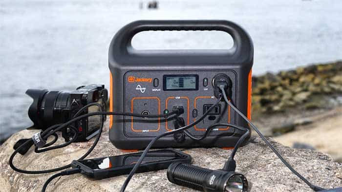 Solar power inverter on a camping trip powering various electronics