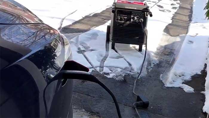 Honda gasoline generator charging a tesla electric car